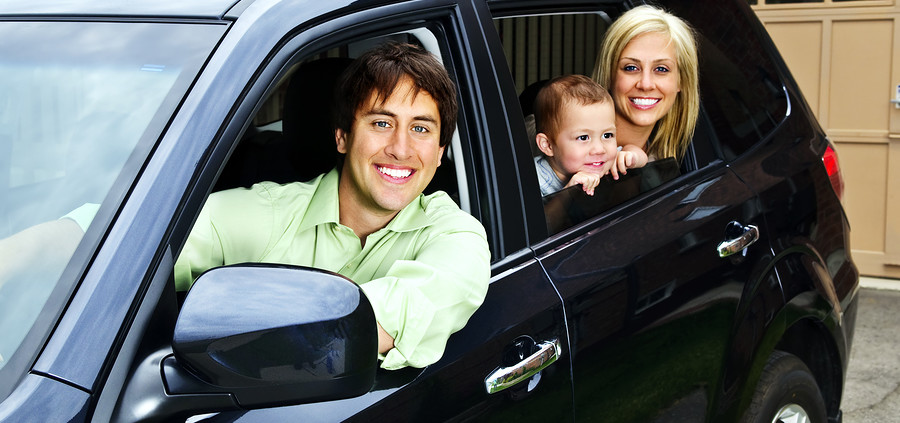 bigstockphoto_happy_family_in_car_5851195